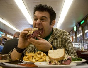 Adam Richman has a light snack.